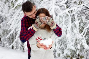 A couple celebrating the festive season with a winter proposal.
