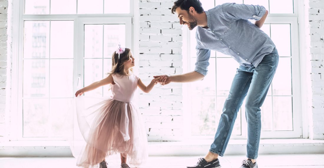 A man dancing with a young girl