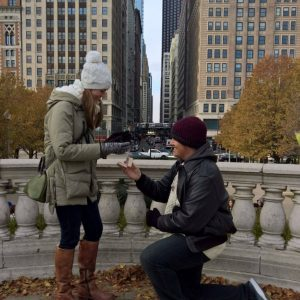 A man proposing at Millennium Park in Chicago.