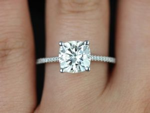 A platinum engagement ring with moissanite and conflict-free diamonds.