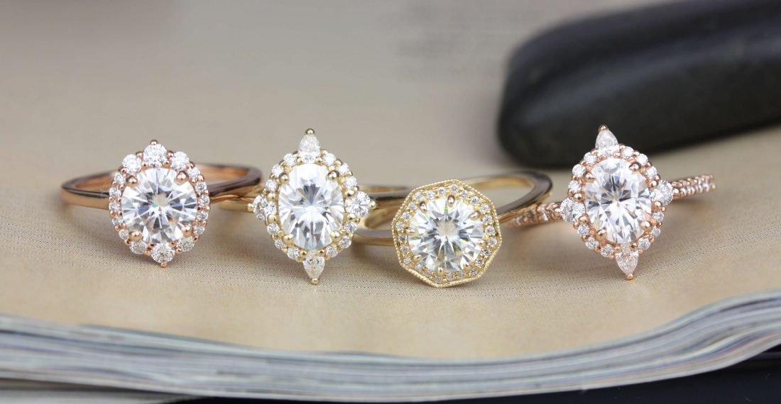Round and oval moissanite gemstone rings with halo settings