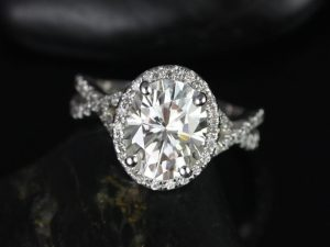 An oval moissanite halo engagement ring made with 14kt White Gold and conflict-free diamond by Love & Promise Jewelers.