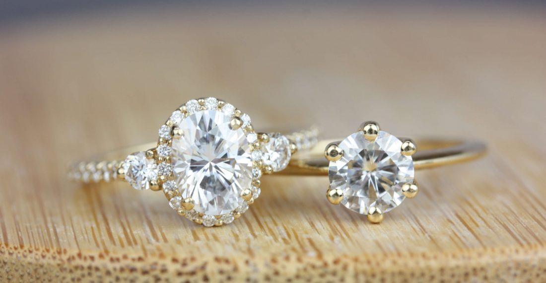 Oval and round moissanite diamond rings with halos