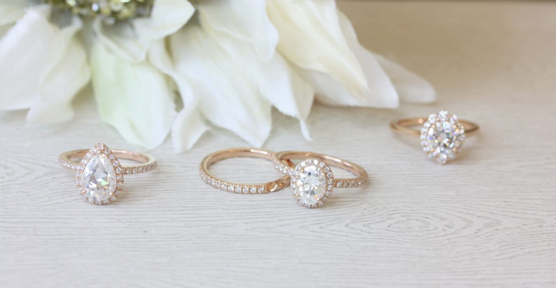 Pear and oval moissanite rings with halo settings