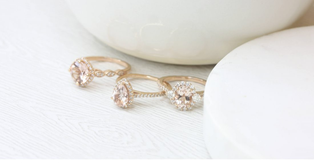 Three rose gold engagement rings with halo settings and milgrain