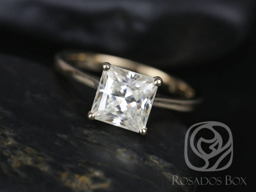 A moissanite princess cut engagement ring made with 14kt yellow gold by Love and Promise Jewelers.