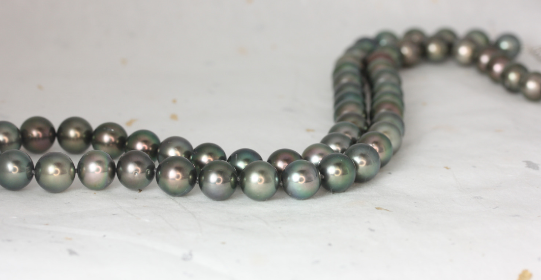 A Tahitian pearl necklace by Love & Promise Jewelers.
