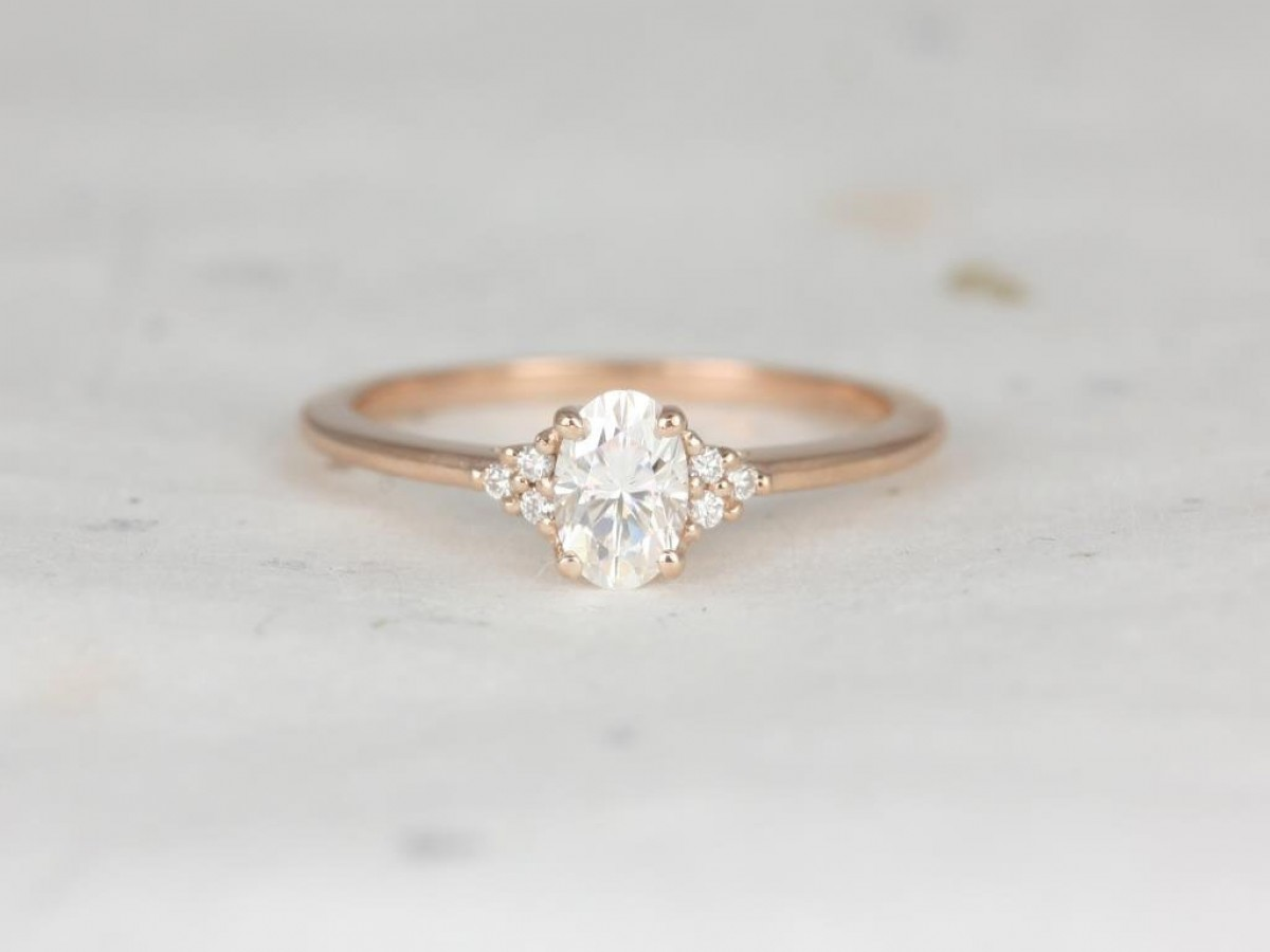 Rose gold 3 stone engagement ring handcrafted with conflict-free diamonds and recycled 14kt rose gold.