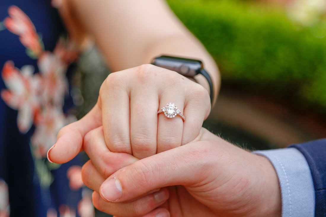 Michaela's engagement ring on her hand