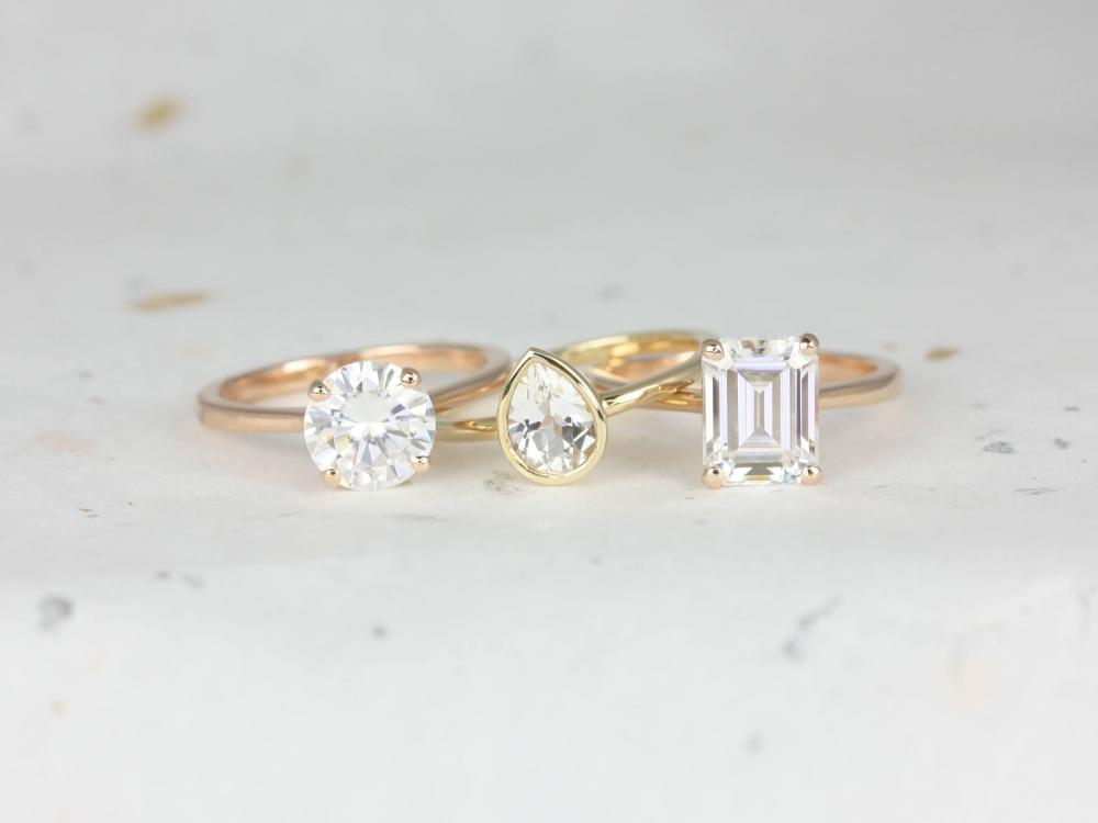 Three differently shaped classic engagement rings.
