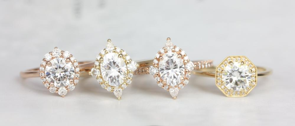 A row of engagement rings in rose gold and gold.