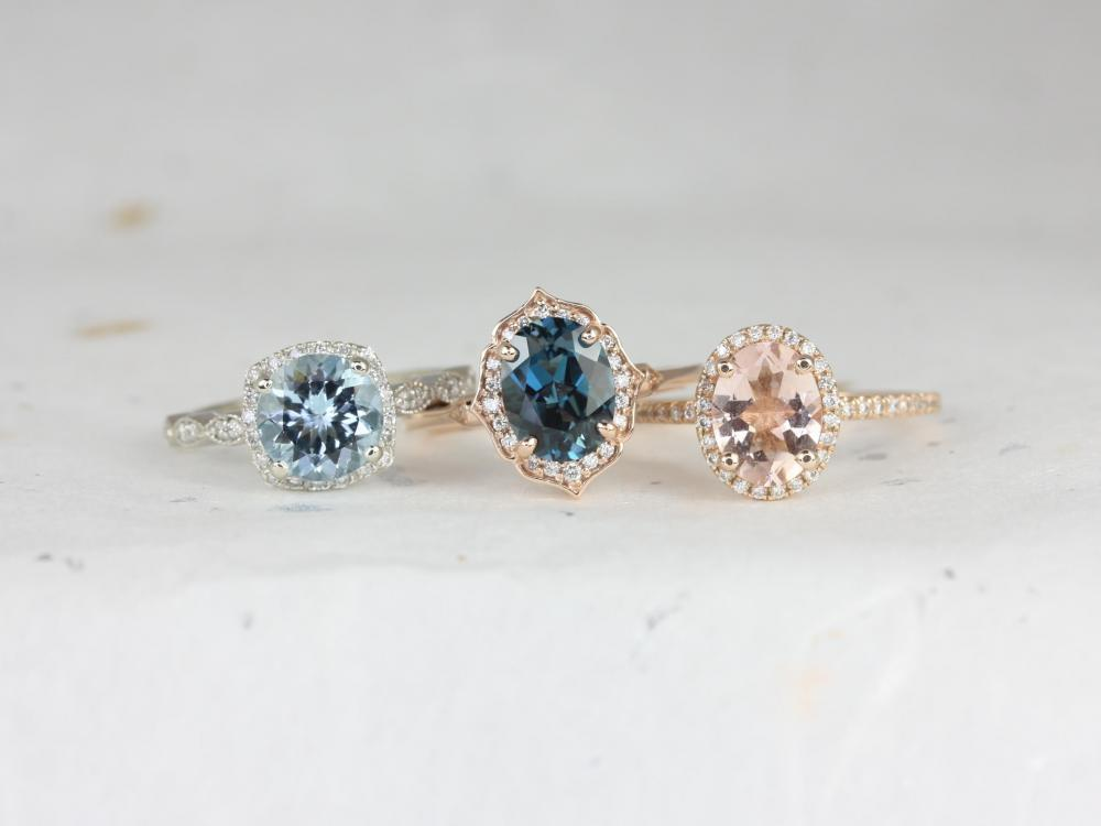 Row of engagement rings with sapphire center gemstones.