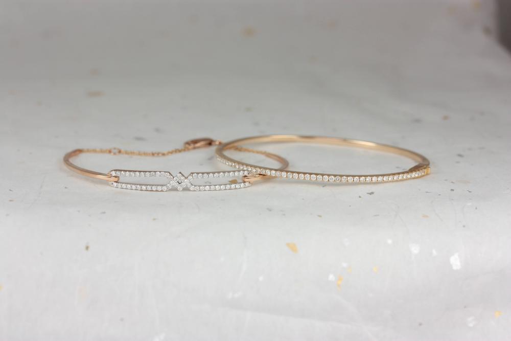 Two rose gold diamond bracelets for women.