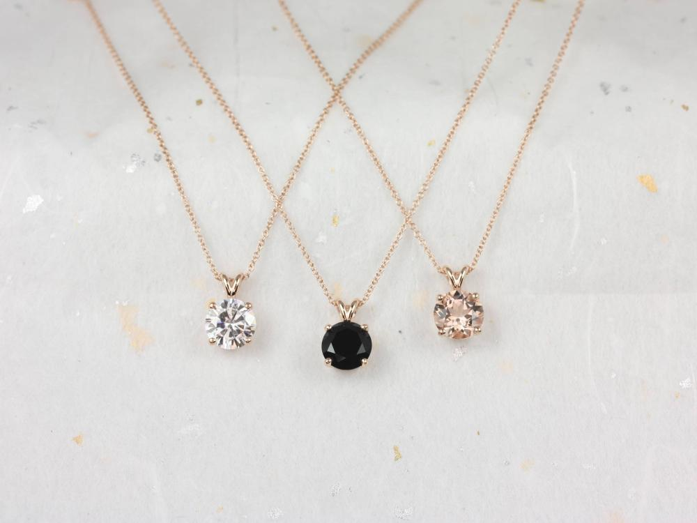 Three necklaces with morganite, moissanite, and black onyx.