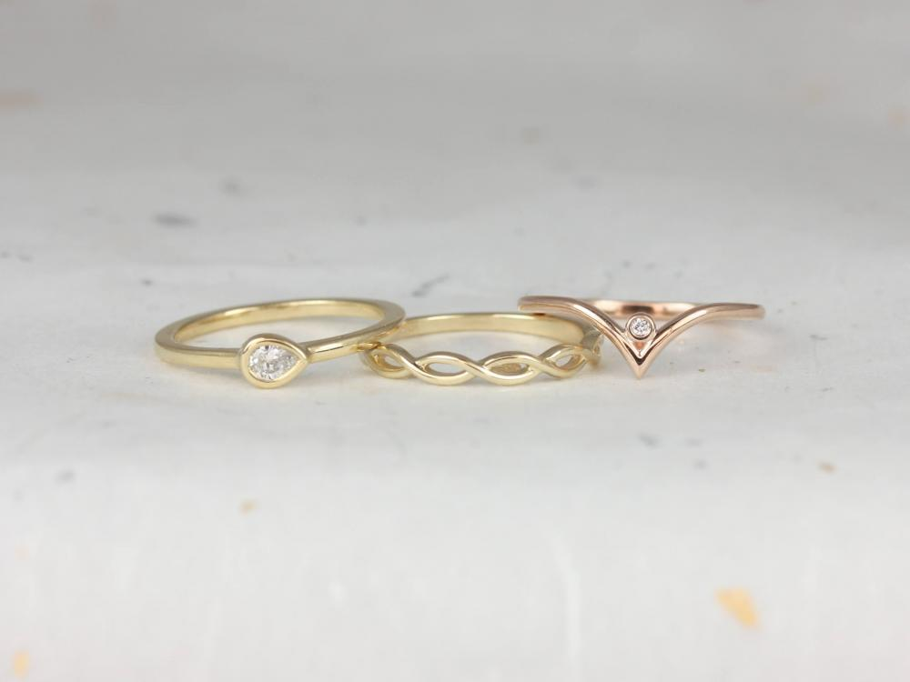 Three gold and rose gold bands.