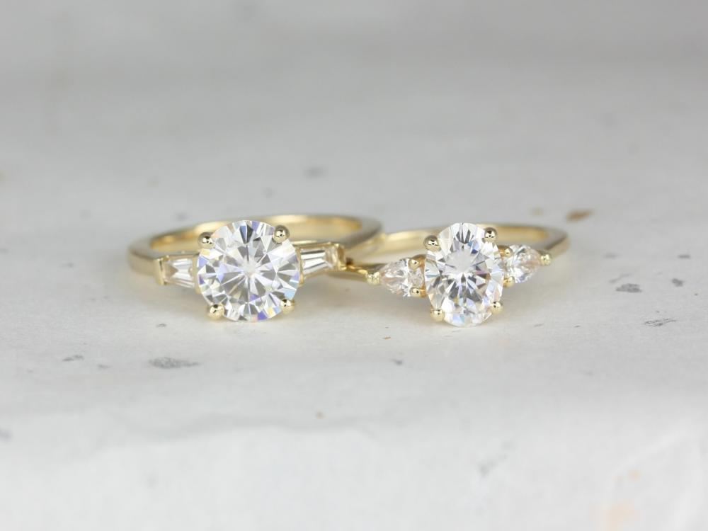 Pair of three-stone engagement rings.
