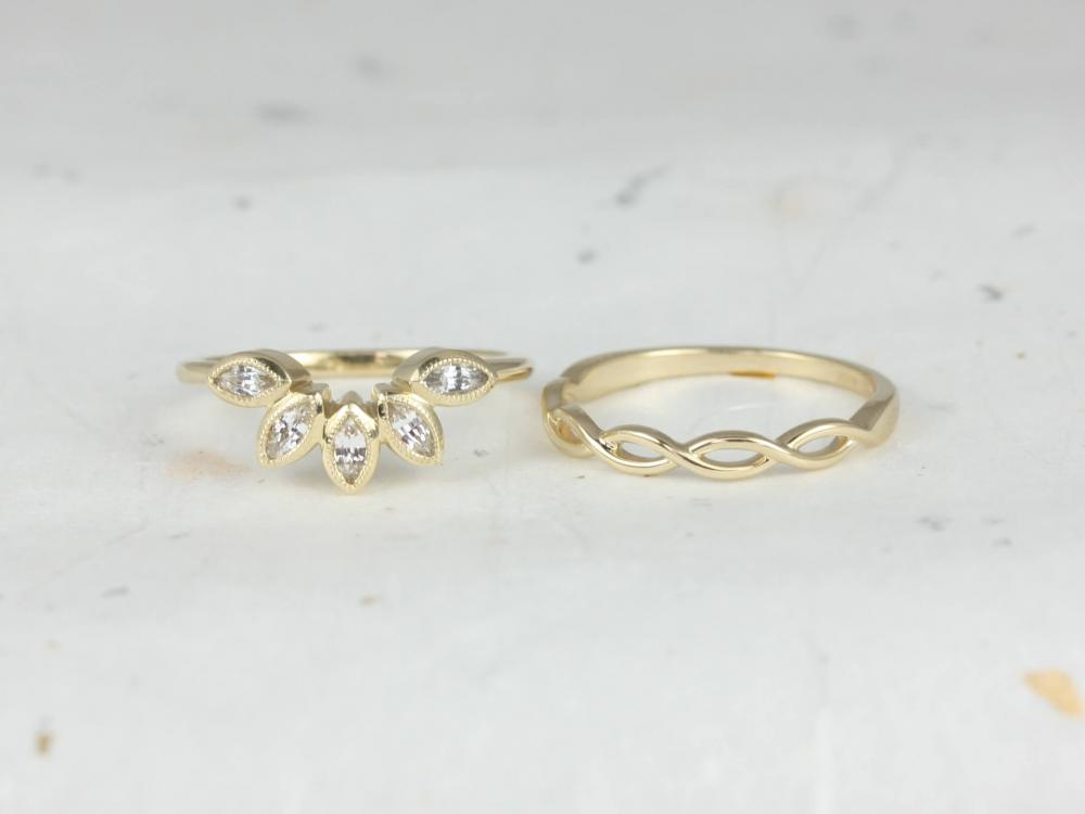 Petal shaped wedding band next to a twist wedding band.