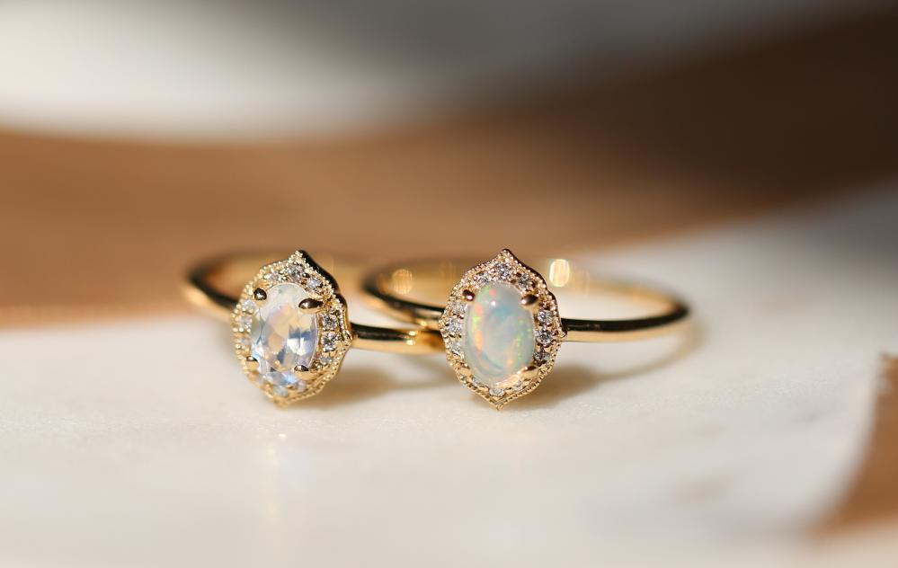 Two overlapping dainty and demi-fine rings from Love & Promise Jewelers.