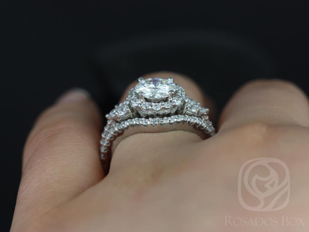 https://www.loveandpromisejewelers.com/media/catalog/product/cache/1b8ff75e92e9e3eb7d814fc024f6d8df/a/m/amora_14kt_white_gold_round_fb_moissanite_and_diamonds_halo_heart_detail_wedding_set_1wm_.jpg