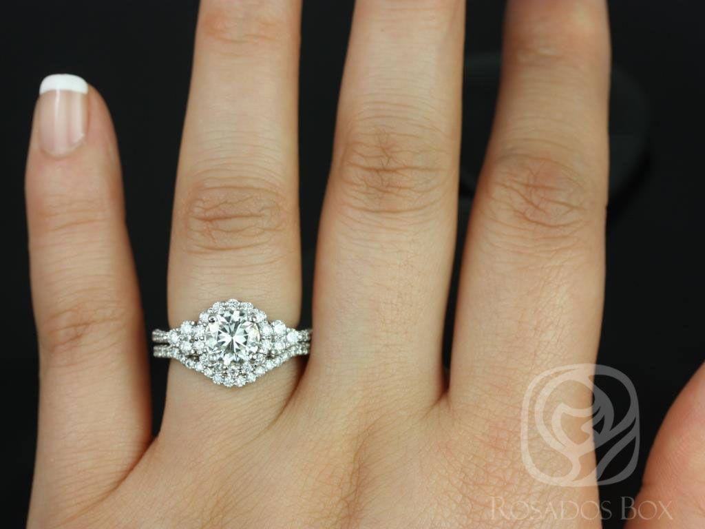 https://www.loveandpromisejewelers.com/media/catalog/product/cache/1b8ff75e92e9e3eb7d814fc024f6d8df/a/m/amora_14kt_white_gold_round_fb_moissanite_and_diamonds_halo_heart_detail_wedding_set_4wm_.jpg