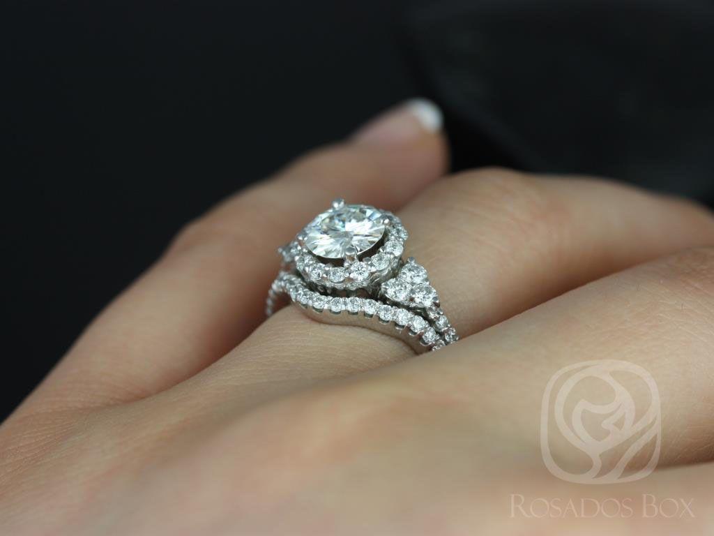 https://www.loveandpromisejewelers.com/media/catalog/product/cache/1b8ff75e92e9e3eb7d814fc024f6d8df/a/m/amora_14kt_white_gold_round_fb_moissanite_and_diamonds_halo_heart_detail_wedding_set_5wm_.jpg