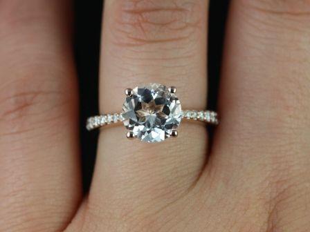 https://www.loveandpromisejewelers.com/media/catalog/product/cache/1b8ff75e92e9e3eb7d814fc024f6d8df/b/_/b._taylor_9mm_white_topaz_14kt_rose_gold_2_.jpg