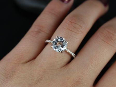 https://www.loveandpromisejewelers.com/media/catalog/product/cache/1b8ff75e92e9e3eb7d814fc024f6d8df/b/_/b._taylor_9mm_white_topaz_14kt_rose_gold_5_.jpg