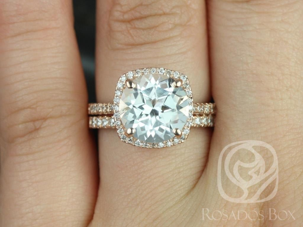 https://www.loveandpromisejewelers.com/media/catalog/product/cache/1b8ff75e92e9e3eb7d814fc024f6d8df/b/a/barra_10mm_14kt_rose_gold_round_white_topaz_and_diamonds_cushion_halo_wedding_set_1wm_.jpg