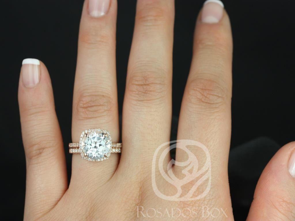 https://www.loveandpromisejewelers.com/media/catalog/product/cache/1b8ff75e92e9e3eb7d814fc024f6d8df/b/a/barra_10mm_14kt_rose_gold_round_white_topaz_and_diamonds_cushion_halo_wedding_set_2wm_.jpg