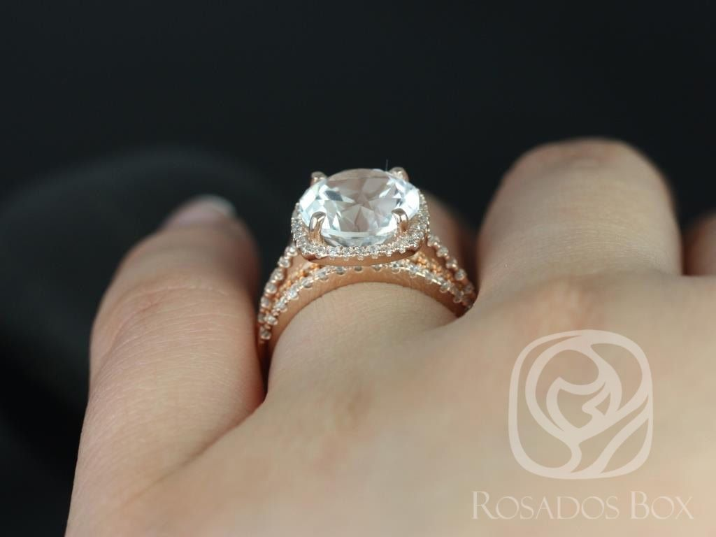 https://www.loveandpromisejewelers.com/media/catalog/product/cache/1b8ff75e92e9e3eb7d814fc024f6d8df/b/a/barra_10mm_14kt_rose_gold_round_white_topaz_and_diamonds_cushion_halo_wedding_set_4wm_.jpg