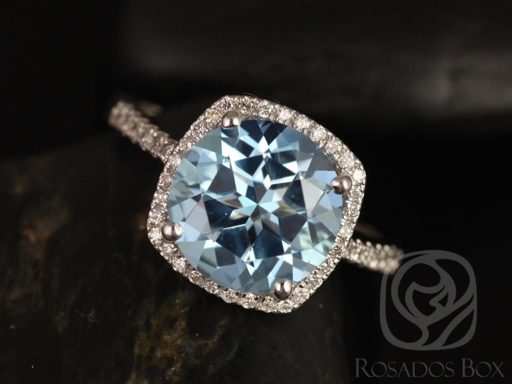 https://www.loveandpromisejewelers.com/media/catalog/product/cache/1b8ff75e92e9e3eb7d814fc024f6d8df/b/a/barra_10mm_14kt_white_gold_blue_topaz_and_diamond_cushion_halo_engagement_ring_other_metals_and_stone_options_available_1wm_1.jpg