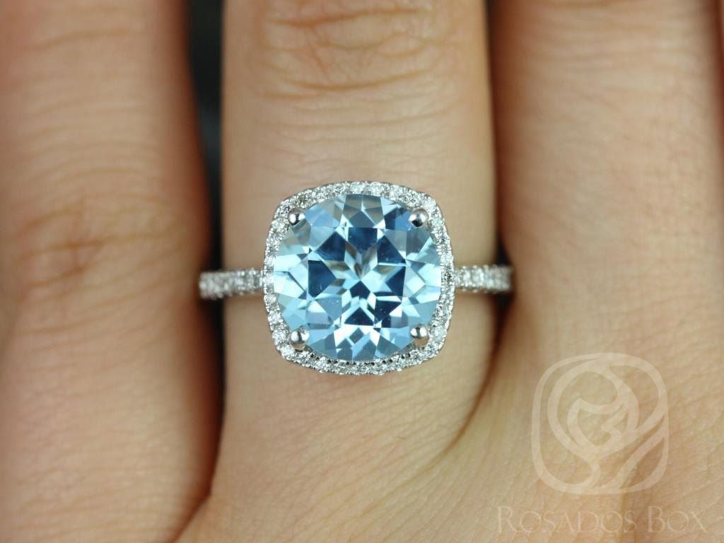 https://www.loveandpromisejewelers.com/media/catalog/product/cache/1b8ff75e92e9e3eb7d814fc024f6d8df/b/a/barra_10mm_14kt_white_gold_blue_topaz_and_diamond_cushion_halo_engagement_ring_other_metals_and_stone_options_available_3wm_1.jpg