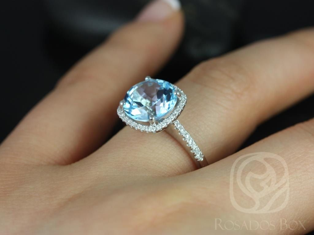 https://www.loveandpromisejewelers.com/media/catalog/product/cache/1b8ff75e92e9e3eb7d814fc024f6d8df/b/a/barra_10mm_14kt_white_gold_blue_topaz_and_diamond_cushion_halo_engagement_ring_other_metals_and_stone_options_available_5wm_1.jpg