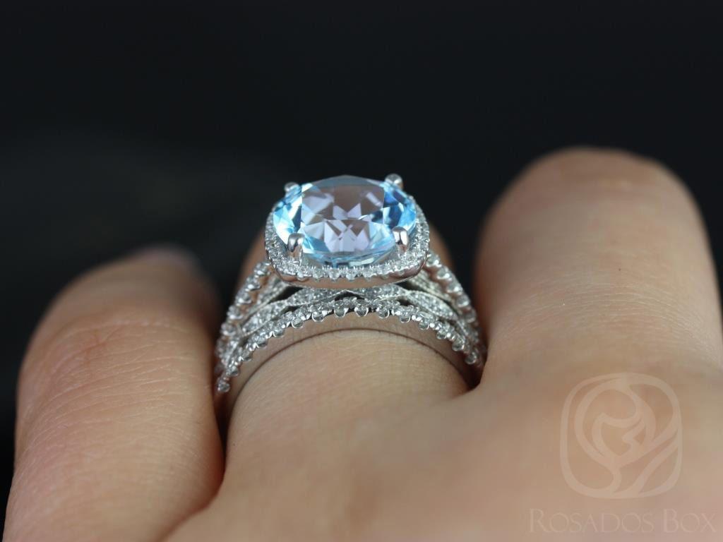 https://www.loveandpromisejewelers.com/media/catalog/product/cache/1b8ff75e92e9e3eb7d814fc024f6d8df/b/a/barra_10mm_christie_14kt_white_gold_blue_topaz_and_diamond_cushion_halo_trio_wedding_set_5wm__1.jpg