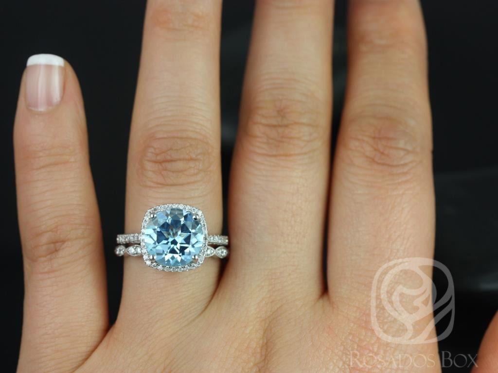 https://www.loveandpromisejewelers.com/media/catalog/product/cache/1b8ff75e92e9e3eb7d814fc024f6d8df/b/a/barra_10mm_christie_14kt_white_gold_blue_topaz_and_diamond_cushion_halo_wedding_set_3wm_.jpg