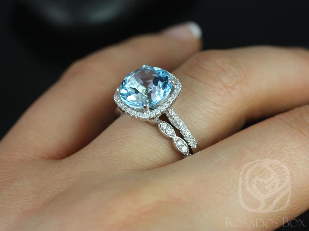 https://www.loveandpromisejewelers.com/media/catalog/product/cache/1b8ff75e92e9e3eb7d814fc024f6d8df/b/a/barra_10mm_christie_14kt_white_gold_blue_topaz_and_diamond_cushion_halo_wedding_set_4wm_.jpg