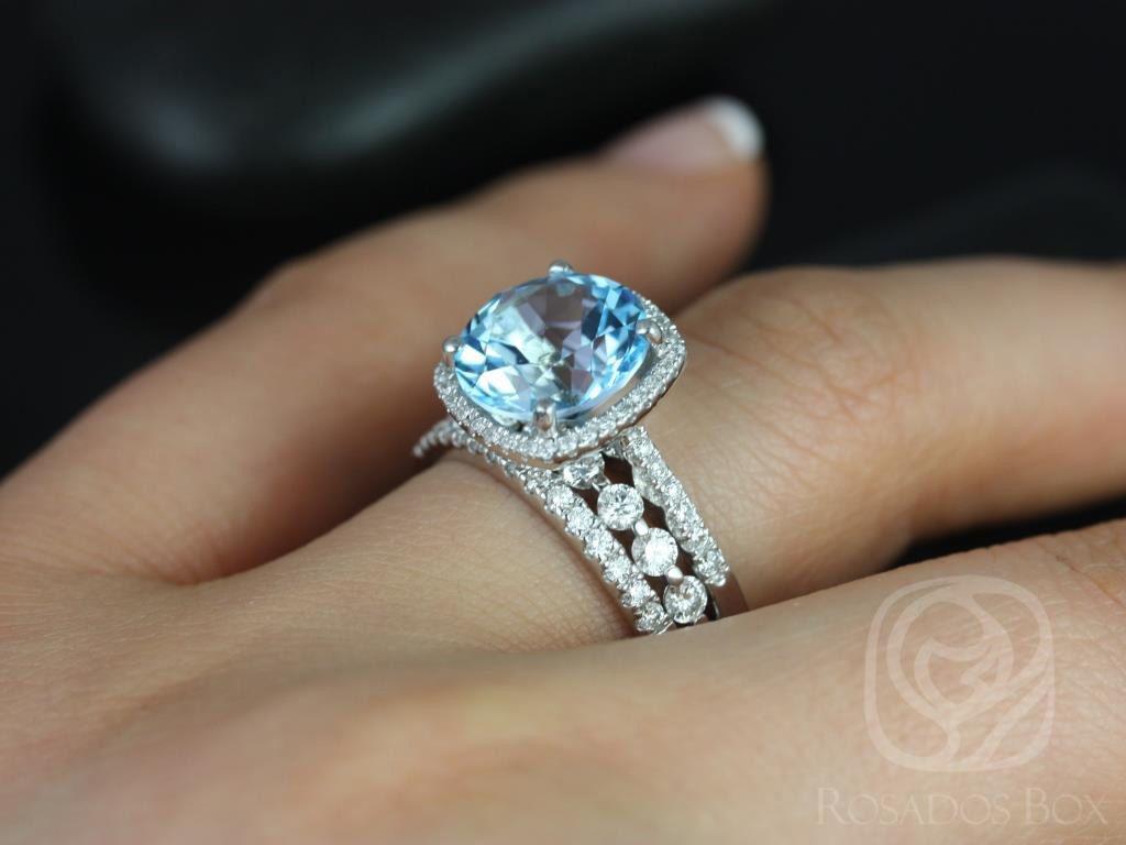 https://www.loveandpromisejewelers.com/media/catalog/product/cache/1b8ff75e92e9e3eb7d814fc024f6d8df/b/a/barra_10mm_medio_bubble_breathe_14kt_white_gold_blue_topaz_and_diamond_halo_trio_wedding_set_4wm_.jpg