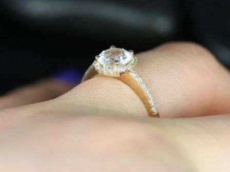 https://www.loveandpromisejewelers.com/media/catalog/product/cache/1b8ff75e92e9e3eb7d814fc024f6d8df/b/a/barra_6mm_petite_size_14kt_yellow_gold_thin_white_topaz_and_diamonds_cushion_halo_engagement_ring_5.jpg