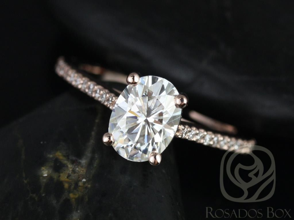 https://www.loveandpromisejewelers.com/media/catalog/product/cache/1b8ff75e92e9e3eb7d814fc024f6d8df/b/l/blake_8x6mm_14kt_rose_gold_oval_fb_moissanite_and_diamonds_cathedral_engagement_ring_other_metals_and_stone_options_available_1wm.jpg