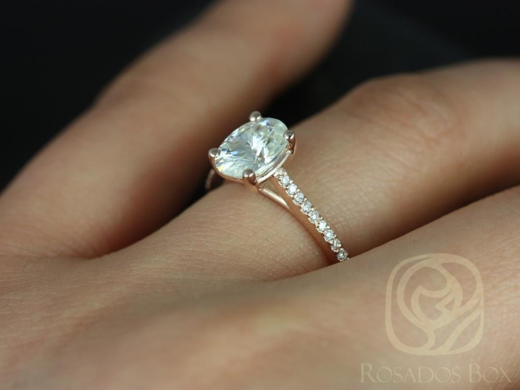 https://www.loveandpromisejewelers.com/media/catalog/product/cache/1b8ff75e92e9e3eb7d814fc024f6d8df/b/l/blake_8x6mm_14kt_rose_gold_oval_fb_moissanite_and_diamonds_cathedral_engagement_ring_other_metals_and_stone_options_available_5wm.jpg