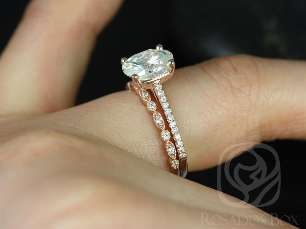 https://www.loveandpromisejewelers.com/media/catalog/product/cache/1b8ff75e92e9e3eb7d814fc024f6d8df/b/l/blake_medio_ultra_petite_bead_eye_14kt_rose_gold_oval_fb_moissanite_and_diamonds_wedding_set_2wm_.jpg