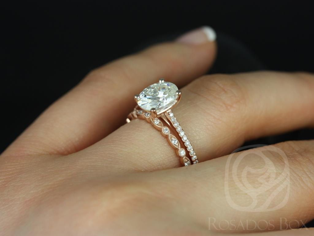 https://www.loveandpromisejewelers.com/media/catalog/product/cache/1b8ff75e92e9e3eb7d814fc024f6d8df/b/l/blake_medio_ultra_petite_bead_eye_14kt_rose_gold_oval_fb_moissanite_and_diamonds_wedding_set_5wm_.jpg