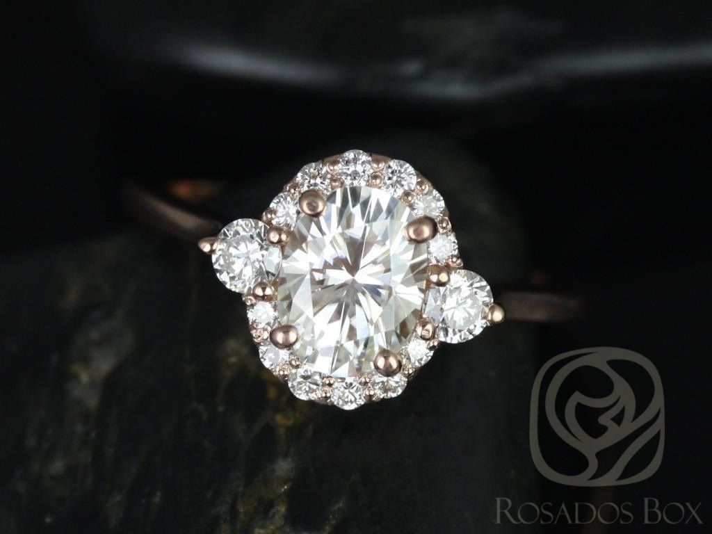 https://www.loveandpromisejewelers.com/media/catalog/product/cache/1b8ff75e92e9e3eb7d814fc024f6d8df/b/r/britney_8x6mm_14kt_rose_gold_oval_fb_moissanite_and_diamonds_halo_engagement_ring_other_metals_and_stone_options_available_1wm.jpg