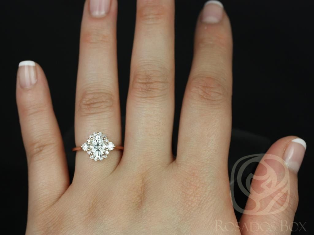 https://www.loveandpromisejewelers.com/media/catalog/product/cache/1b8ff75e92e9e3eb7d814fc024f6d8df/b/r/britney_8x6mm_14kt_rose_gold_oval_fb_moissanite_and_diamonds_halo_engagement_ring_other_metals_and_stone_options_available_4wm.jpg