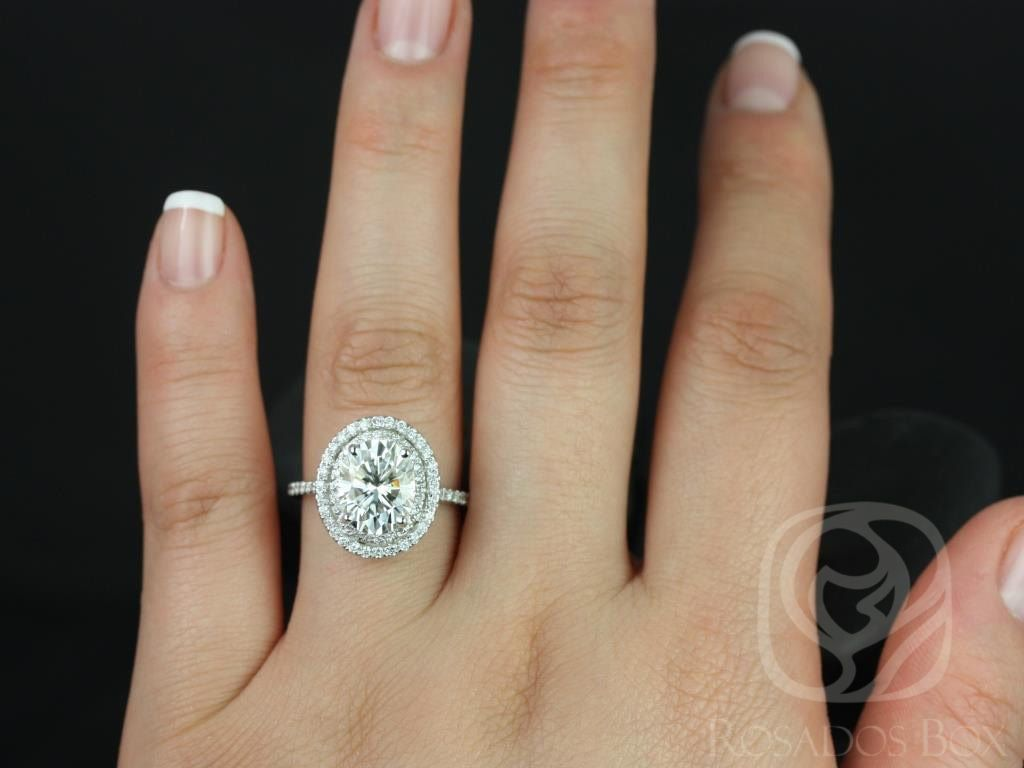 https://www.loveandpromisejewelers.com/media/catalog/product/cache/1b8ff75e92e9e3eb7d814fc024f6d8df/c/a/cara_10x8mm_14kt_white_gold_oval_fb_moissanite_and_diamonds_double_halo_engagement_ring_other_metals_and_stone_options_available_4wm.jpg