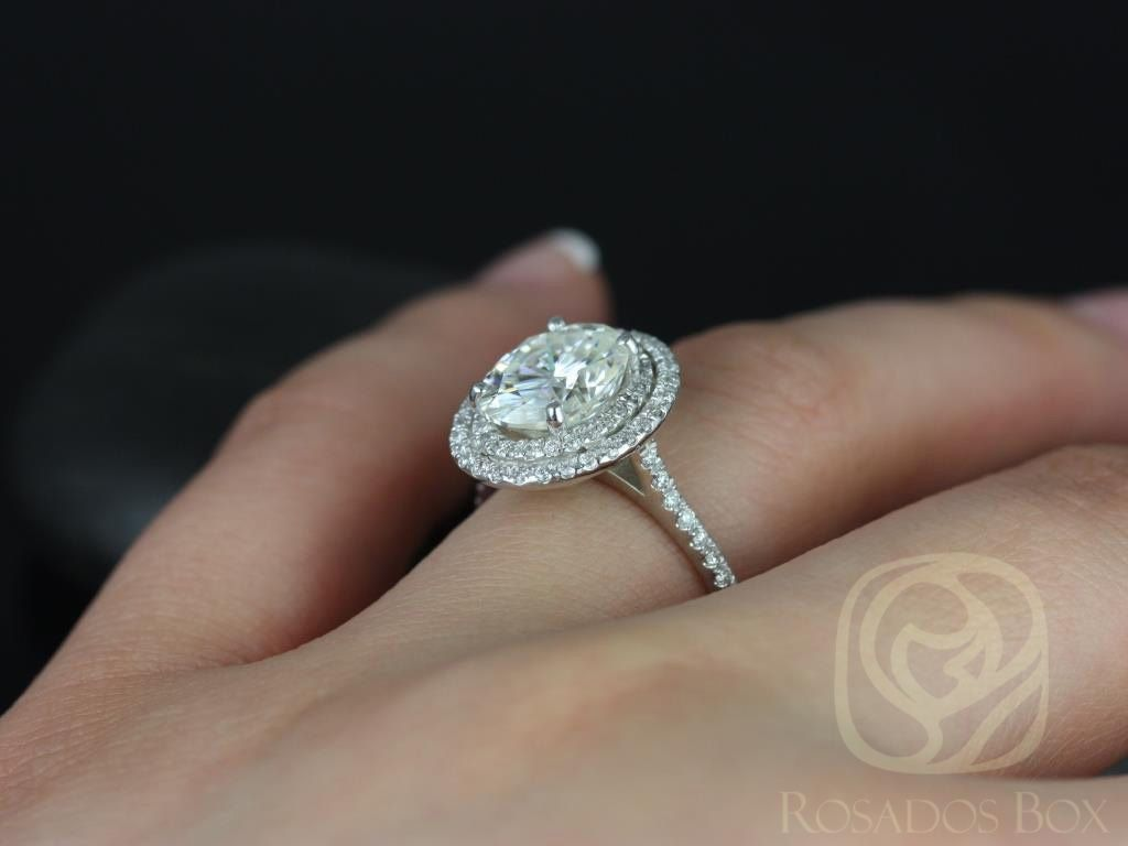 https://www.loveandpromisejewelers.com/media/catalog/product/cache/1b8ff75e92e9e3eb7d814fc024f6d8df/c/a/cara_10x8mm_14kt_white_gold_oval_fb_moissanite_and_diamonds_double_halo_engagement_ring_other_metals_and_stone_options_available_5wm.jpg