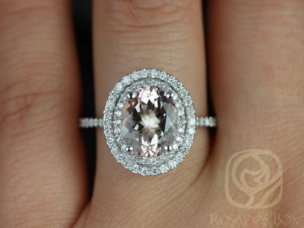https://www.loveandpromisejewelers.com/media/catalog/product/cache/1b8ff75e92e9e3eb7d814fc024f6d8df/c/a/cara_10x8mm_14kt_white_gold_oval_morganite_and_diamonds_double_halo_engagement_ring_other_metals_and_stone_options_available_3wm.jpg