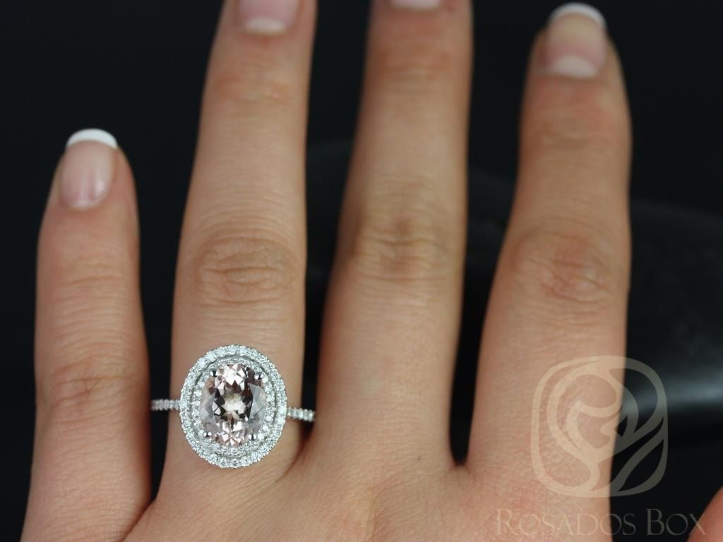 https://www.loveandpromisejewelers.com/media/catalog/product/cache/1b8ff75e92e9e3eb7d814fc024f6d8df/c/a/cara_10x8mm_14kt_white_gold_oval_morganite_and_diamonds_double_halo_engagement_ring_other_metals_and_stone_options_available_4wm.jpg