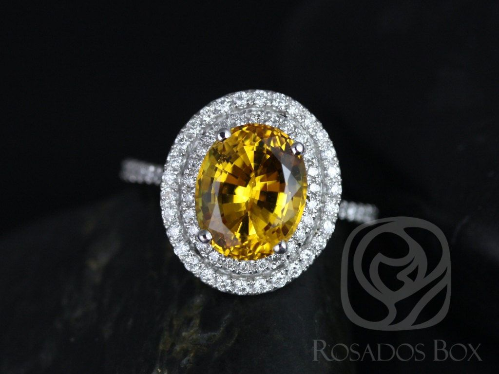 https://www.loveandpromisejewelers.com/media/catalog/product/cache/1b8ff75e92e9e3eb7d814fc024f6d8df/c/a/cara_10x8mm_14kt_white_gold_oval_yellow_sapphire_and_diamonds_double_halo_engagement_ring_1_wm.jpg