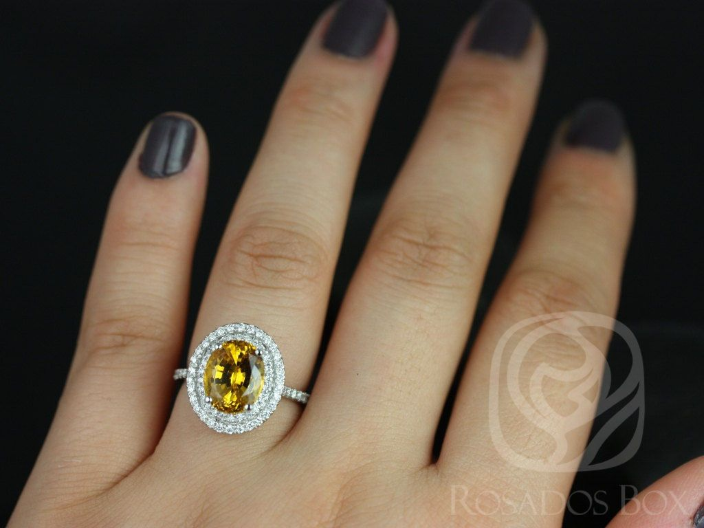 https://www.loveandpromisejewelers.com/media/catalog/product/cache/1b8ff75e92e9e3eb7d814fc024f6d8df/c/a/cara_10x8mm_14kt_white_gold_oval_yellow_sapphire_and_diamonds_double_halo_engagement_ring_3_wm.jpg